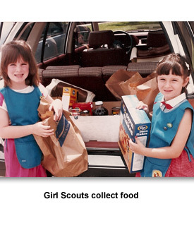 Giving to Others XX Girl Scouts collect food