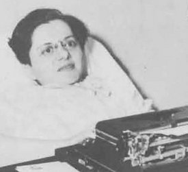Jane Merchant holding one of her books and at her typewriter